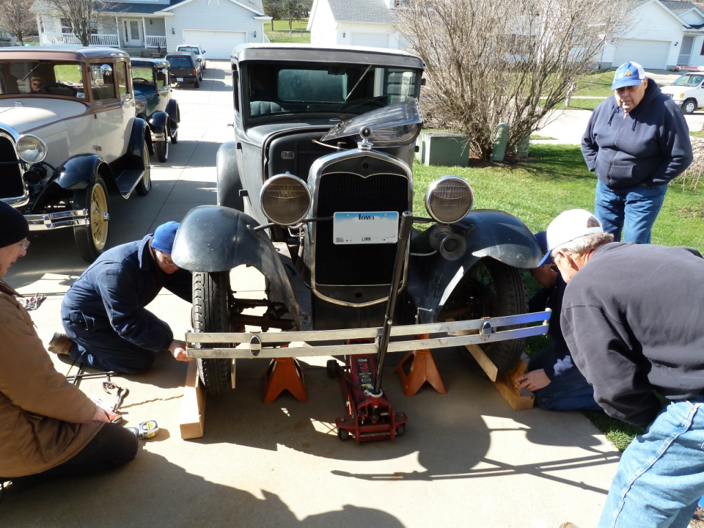 Members working on Clyde, Fred, and Gene's car.